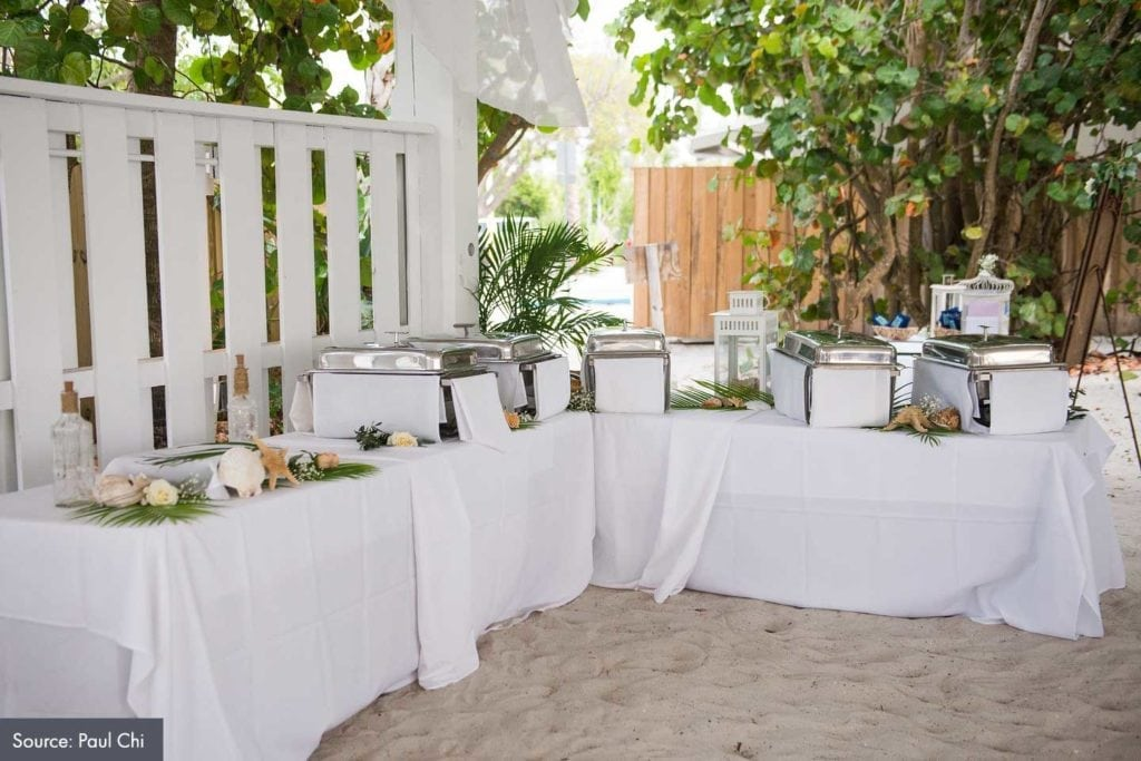 food catering at a beach wedding ceremony at the sandbar pavilion
