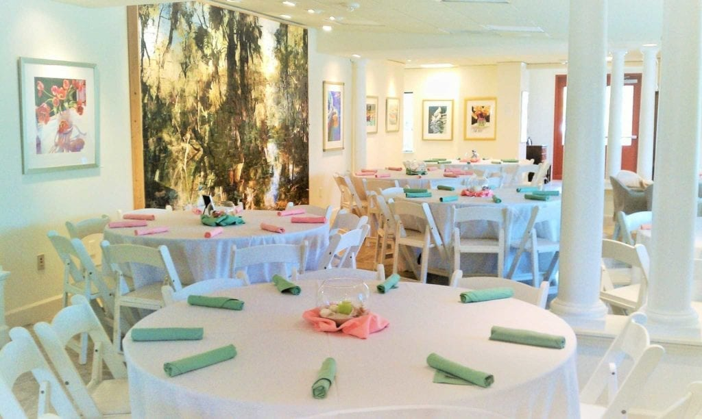set tables inside the Studio at Gulf and Pine for a wedding reception