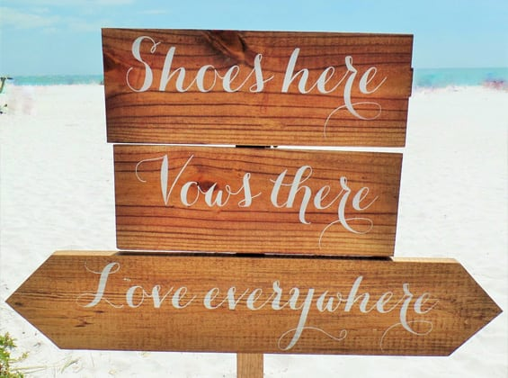 beach wedding sign at ceremony